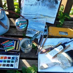Acrylic paints, oil and chalk pastels, 4B, 6B pencils, various brushes, sketchbooks and a tin!