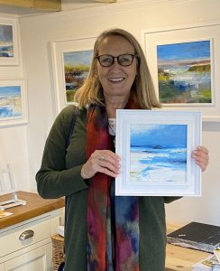 Lisa Timmerman collecting her new painting during Norfolk Open Studios